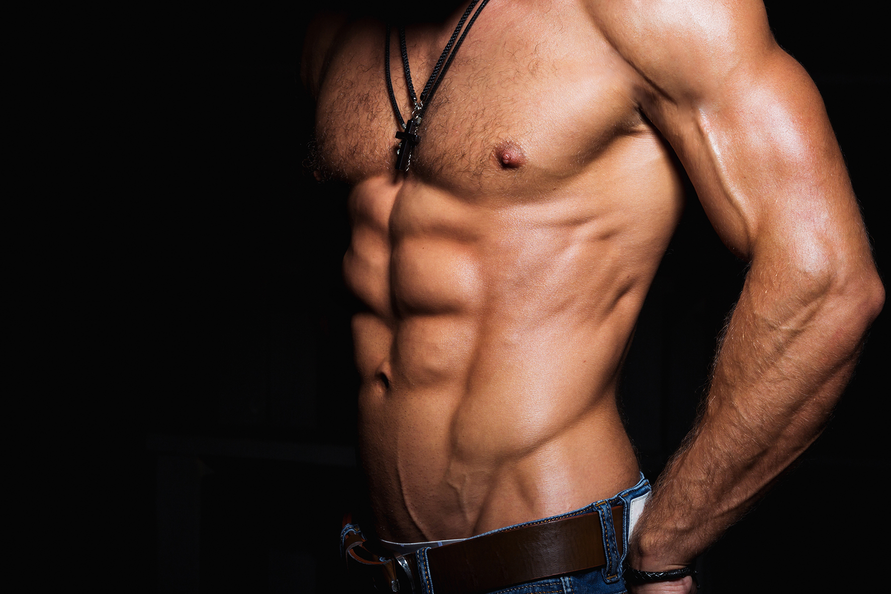 Muscular and sexy torso of young man with perfect abs