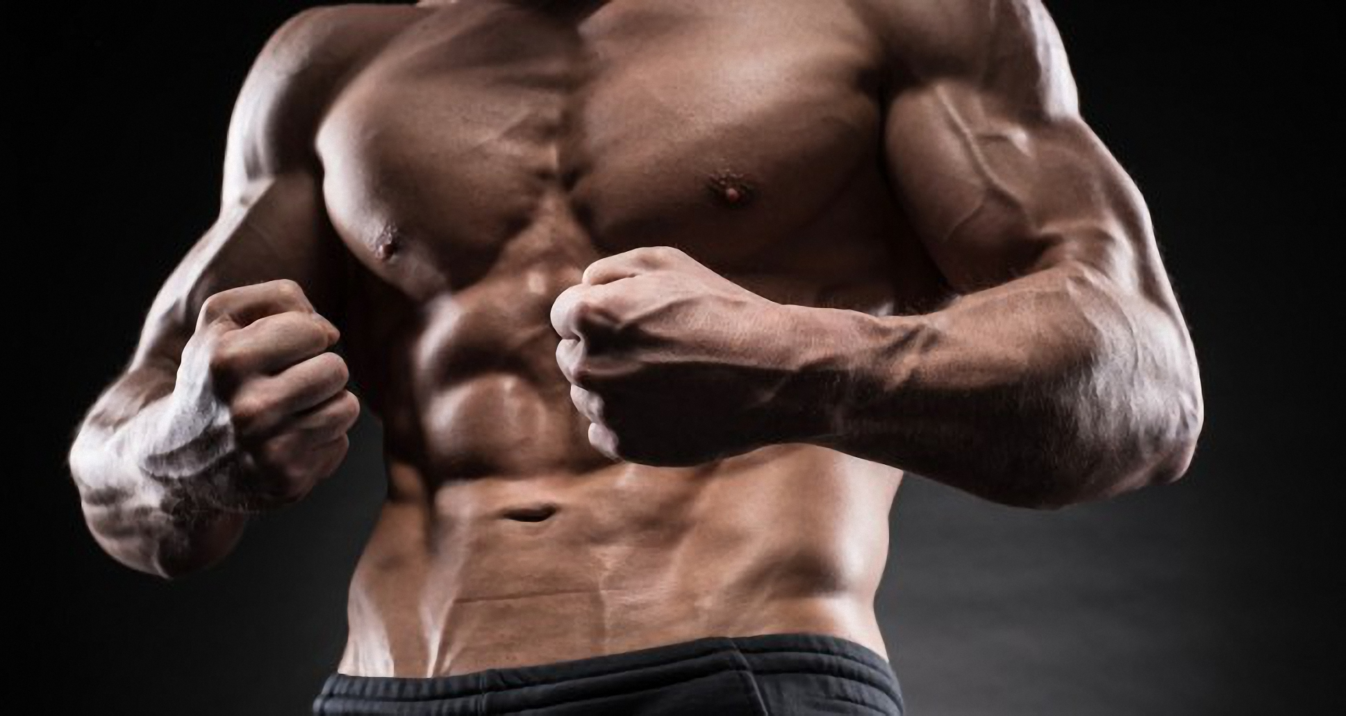 Muscular-young-man-in-studio-on-dark-background-shows-the-different-movements-and-body-parts