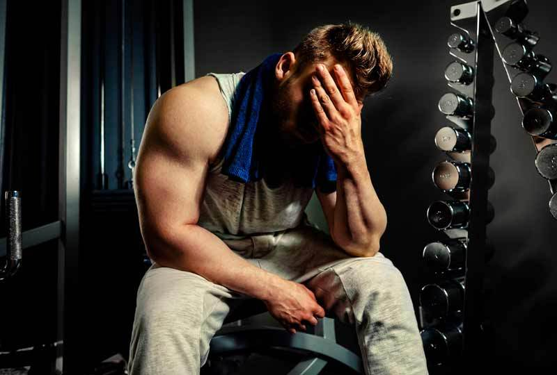 bodybuilder-tired-hand-over-face